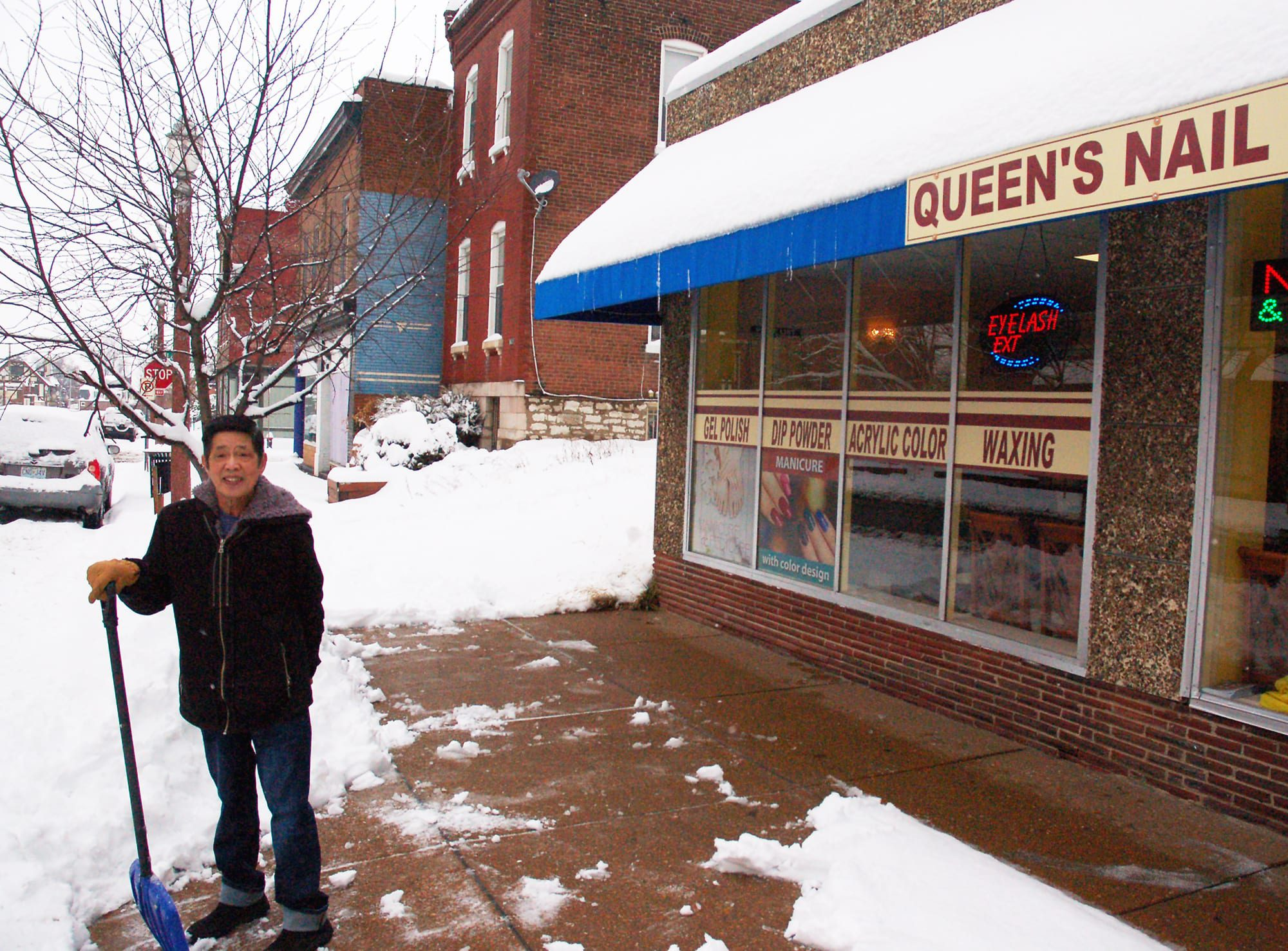 Queen's Nail and Spa on Meramec Street is open in the snow.