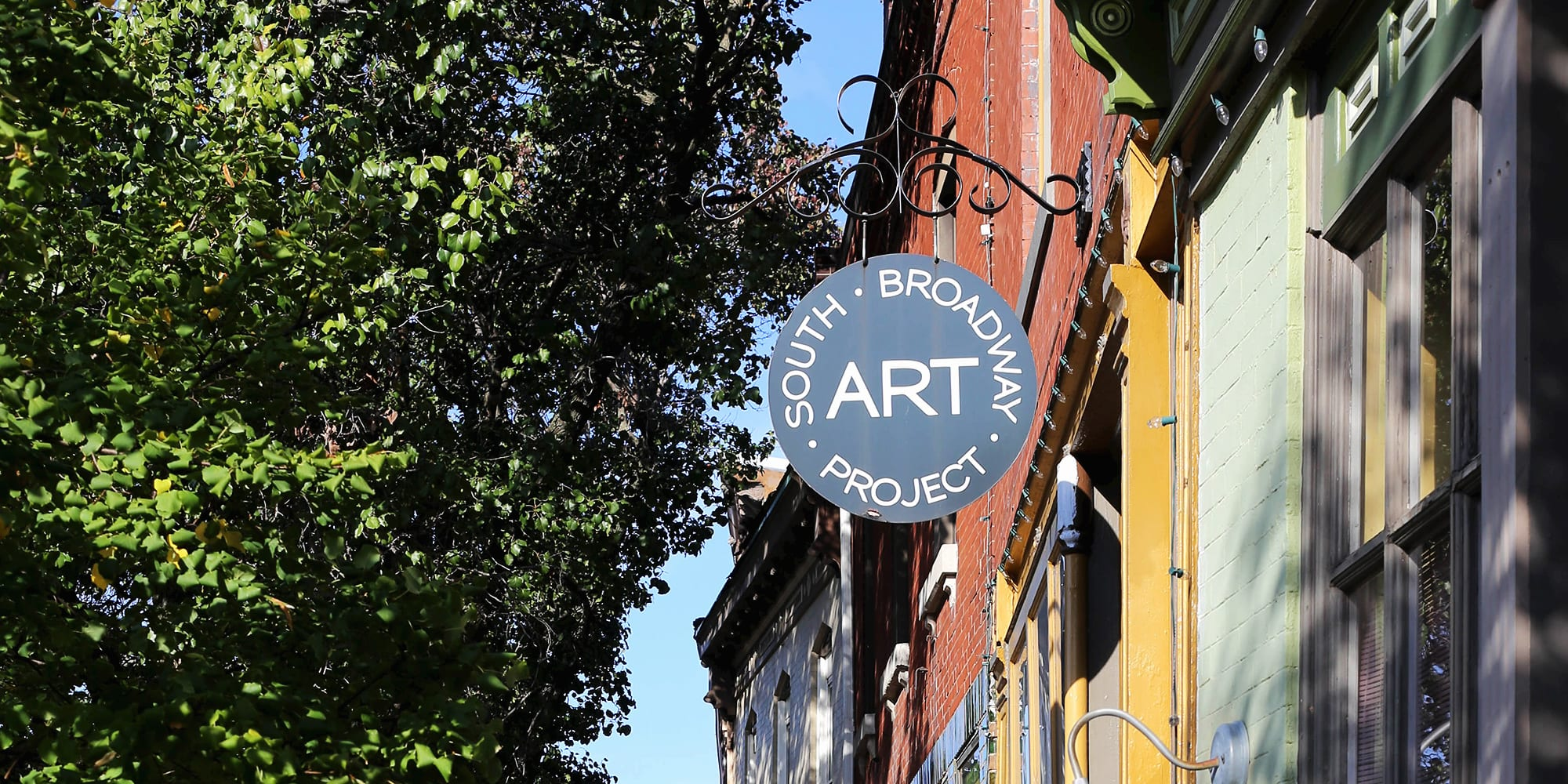 South Broadway Art Project's storefront and sign. Photo by Paul Sableman.