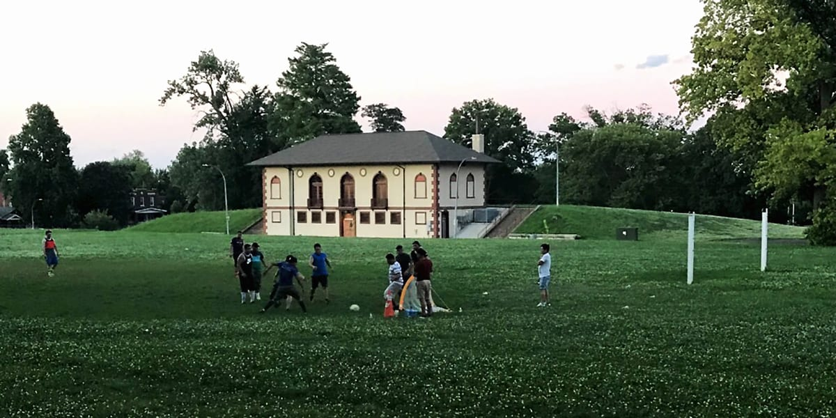 Kids playing soccer in front of the Field House at Marquette Park.
