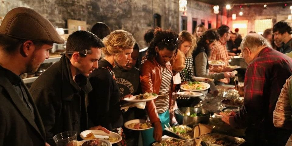Diners at the Cherokee Street Thanksgiving Potluck.