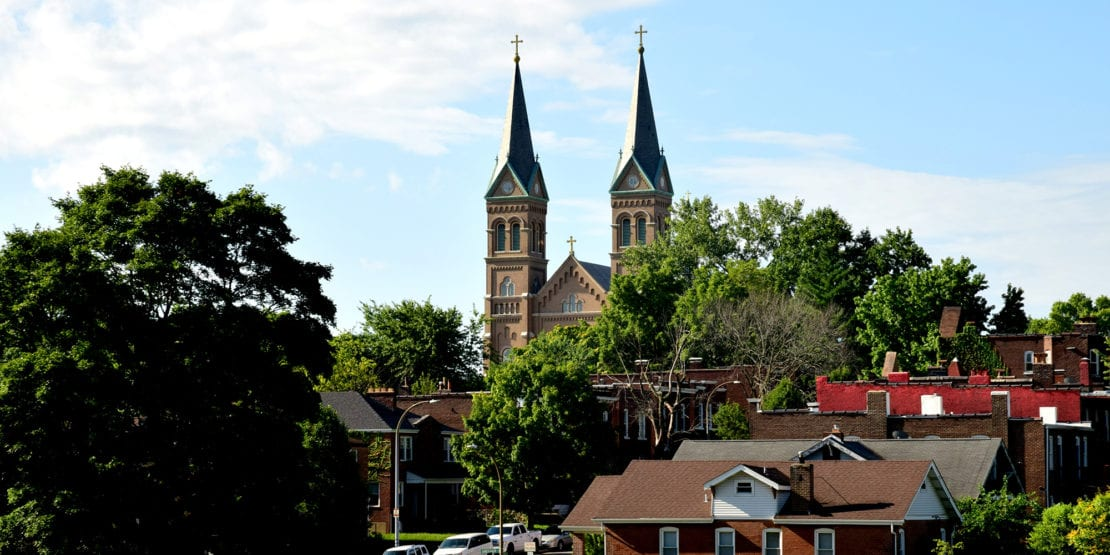 The steeples of St. Anthony of Padua seen from Marquette Park in Dutchtown, St. Louis.