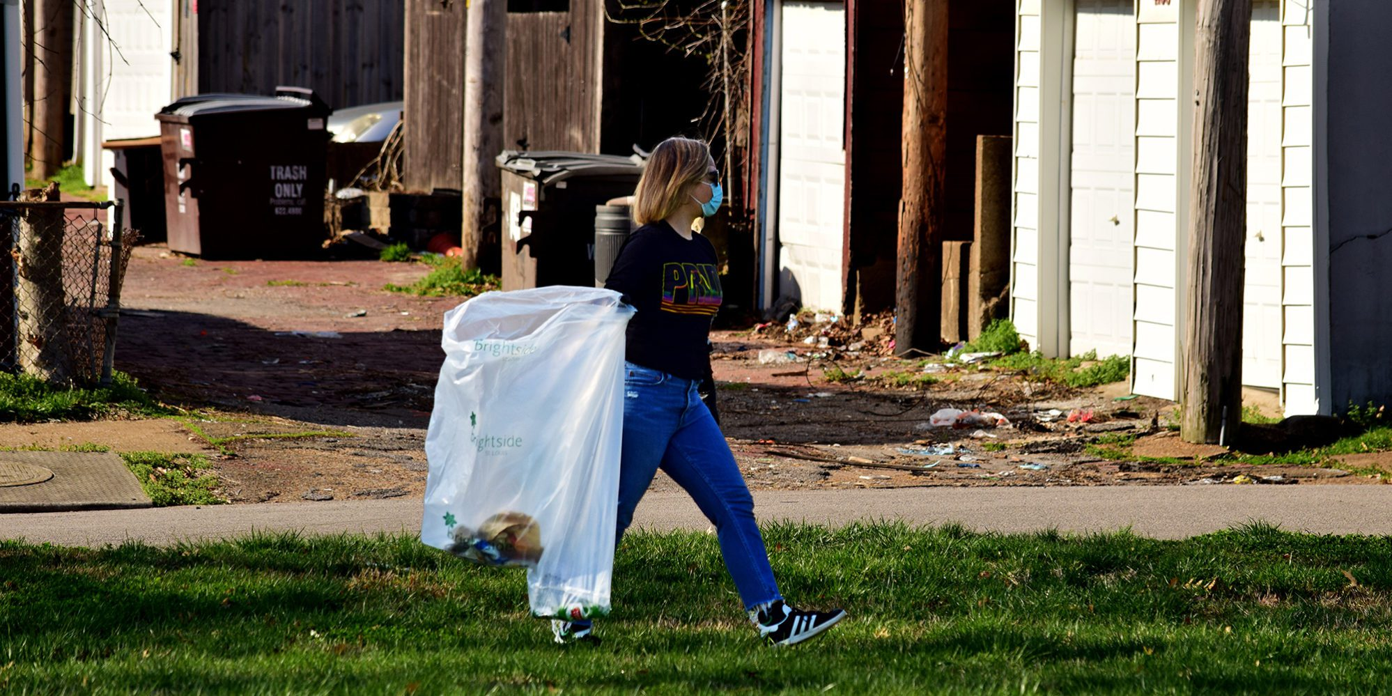 A neighbor cleans up Marquette Park in Dutchtown, St. Louis, MO.