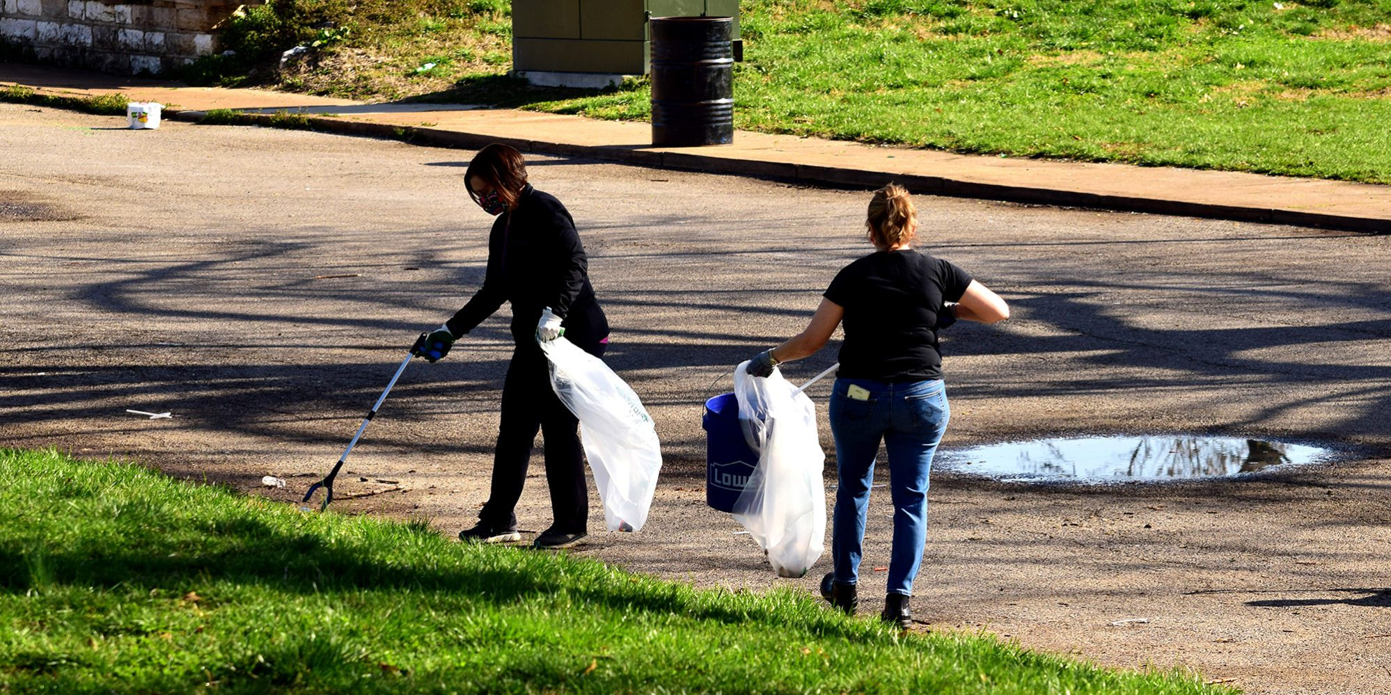 Neighbors cleaning up Marquette Park in Dutchtown, St. Louis.