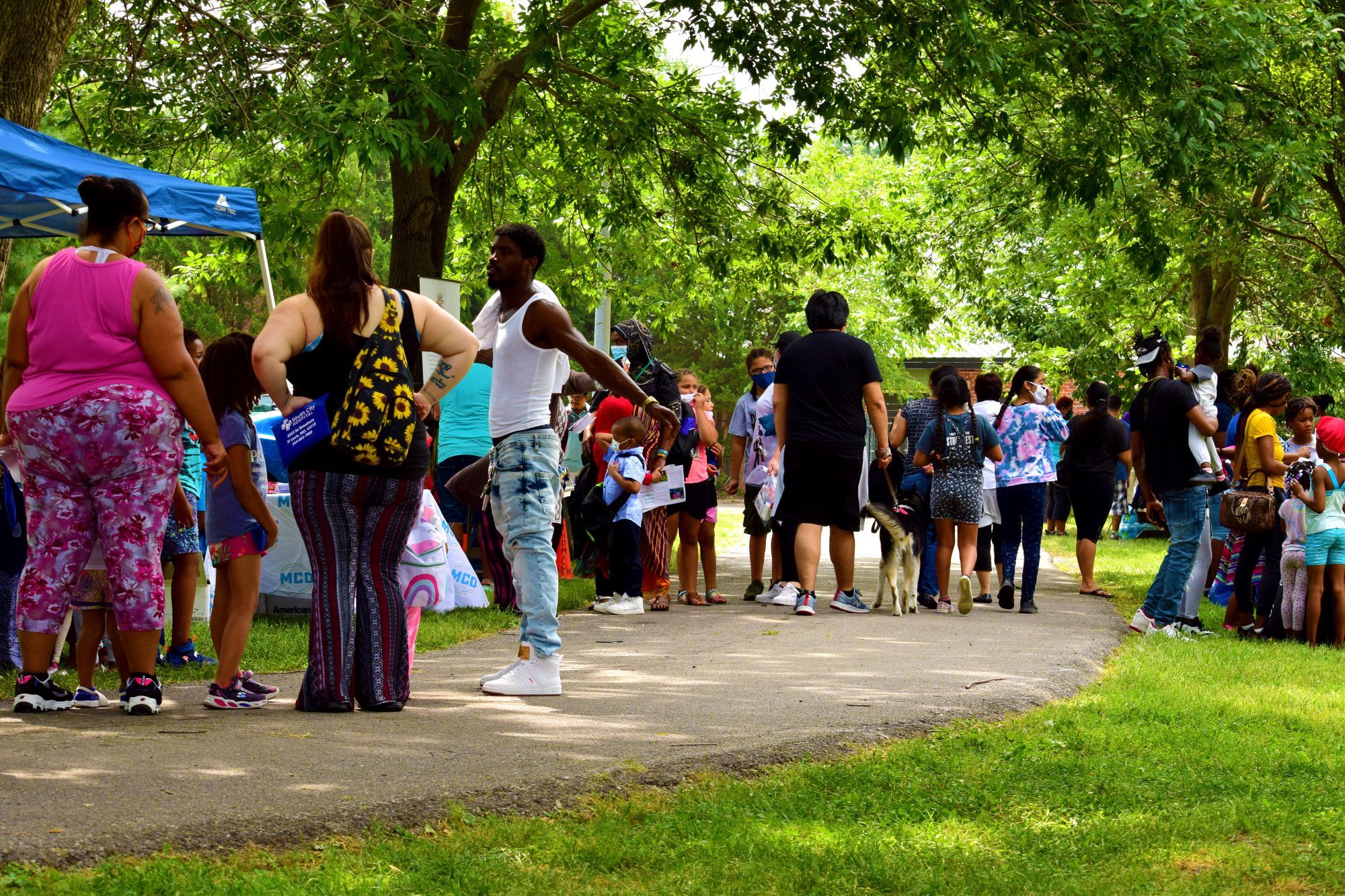 Crowds line up for backpacks and school supplies at Marquette Community Day in Dutchtown, St. Louis, MO.
