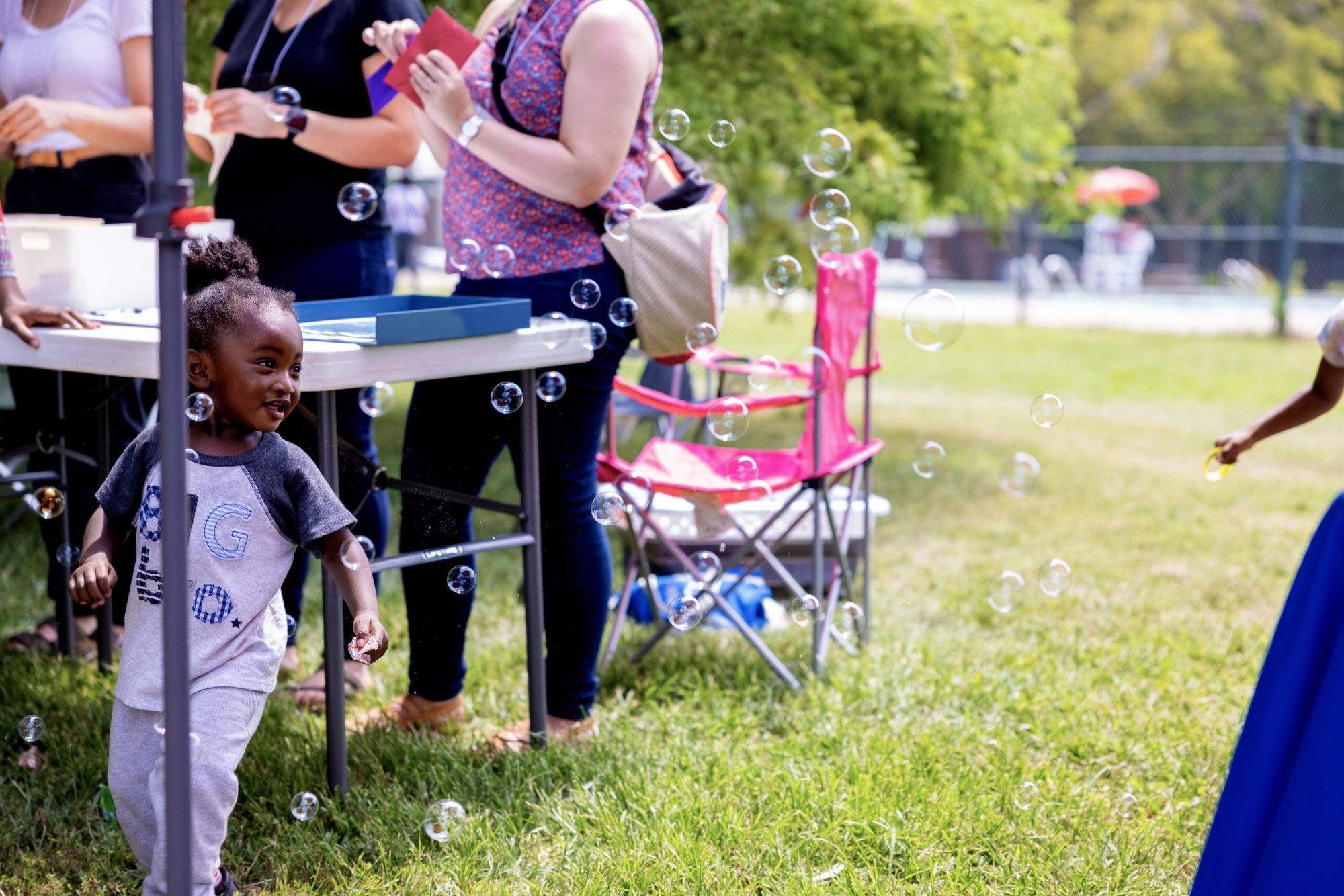 A child playing with bubbles at Marquette Community Day in Dutchtown, St. Louis, MO.