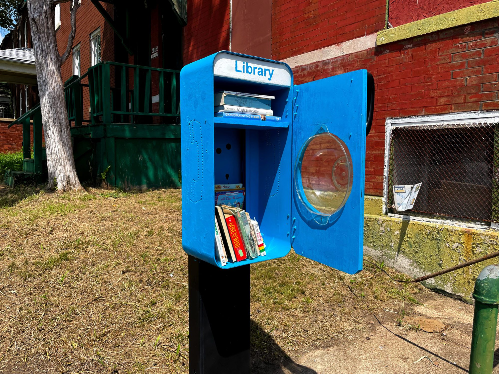 The free little library pay phone stand at 4018 South Grand Boulevard in Dutchtown, St. Louis, MO.