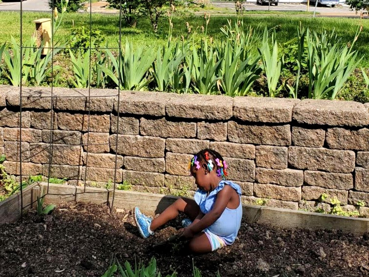 A young child at the VAL Garden in Dutchtown, St. Louis, MO.