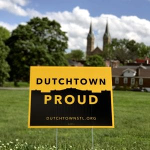 Dutchtown Proud sign overlooking Marquette Park and St. Anthony's steeples.