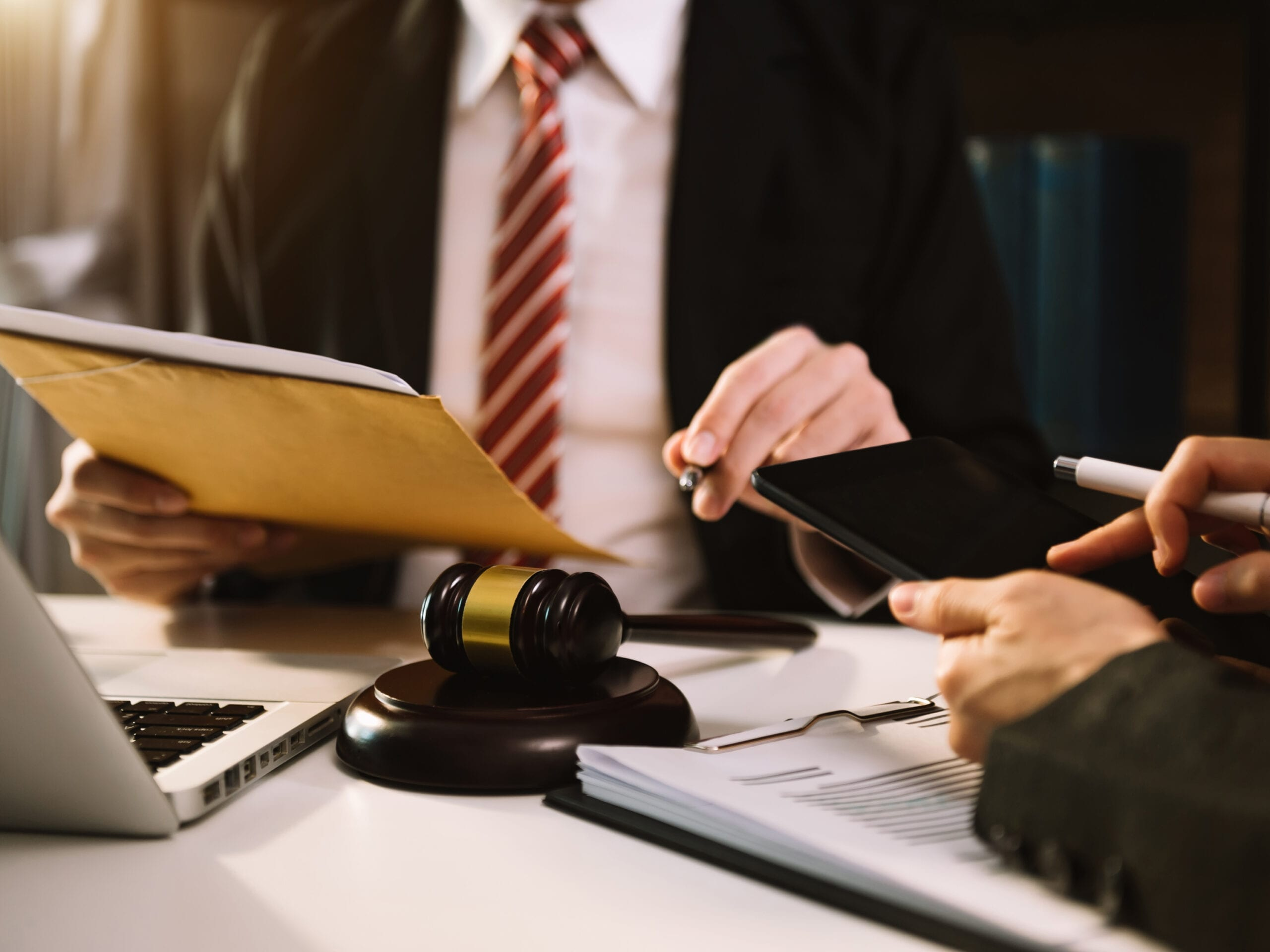 An attorney and a judge discussing commercial litigation matters. RDM has extensive commercial litigation experience.