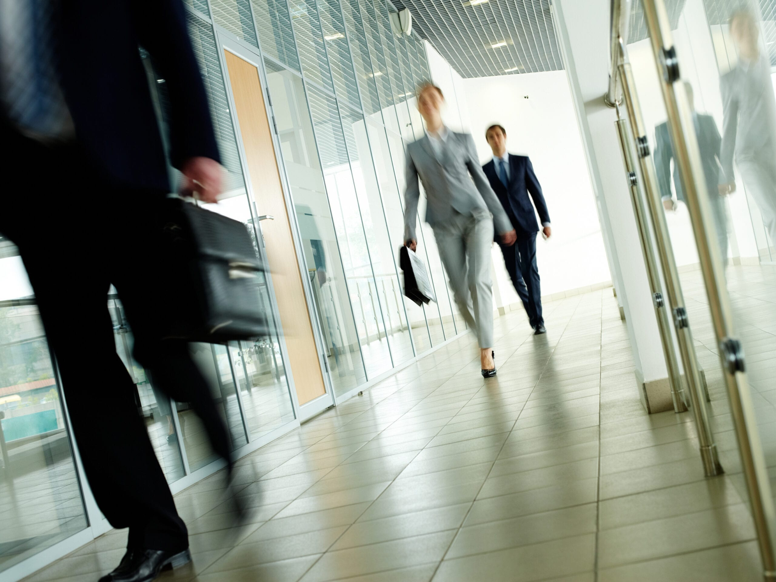 Business people walking down a hallway. RDM has extensive experience in employment and labor law.