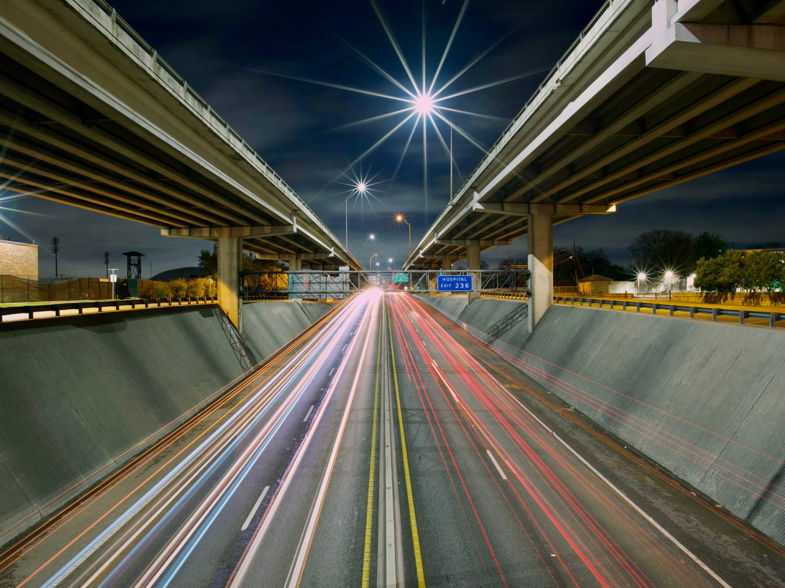 A highway at night. RDM has extensive experience in the field of transportation litigation.