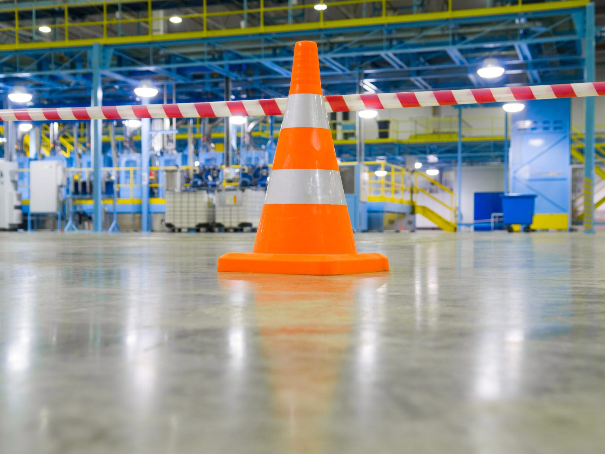 A safety cone in a manufacturing facility. RDM has extensive experience defending premises liability claims.