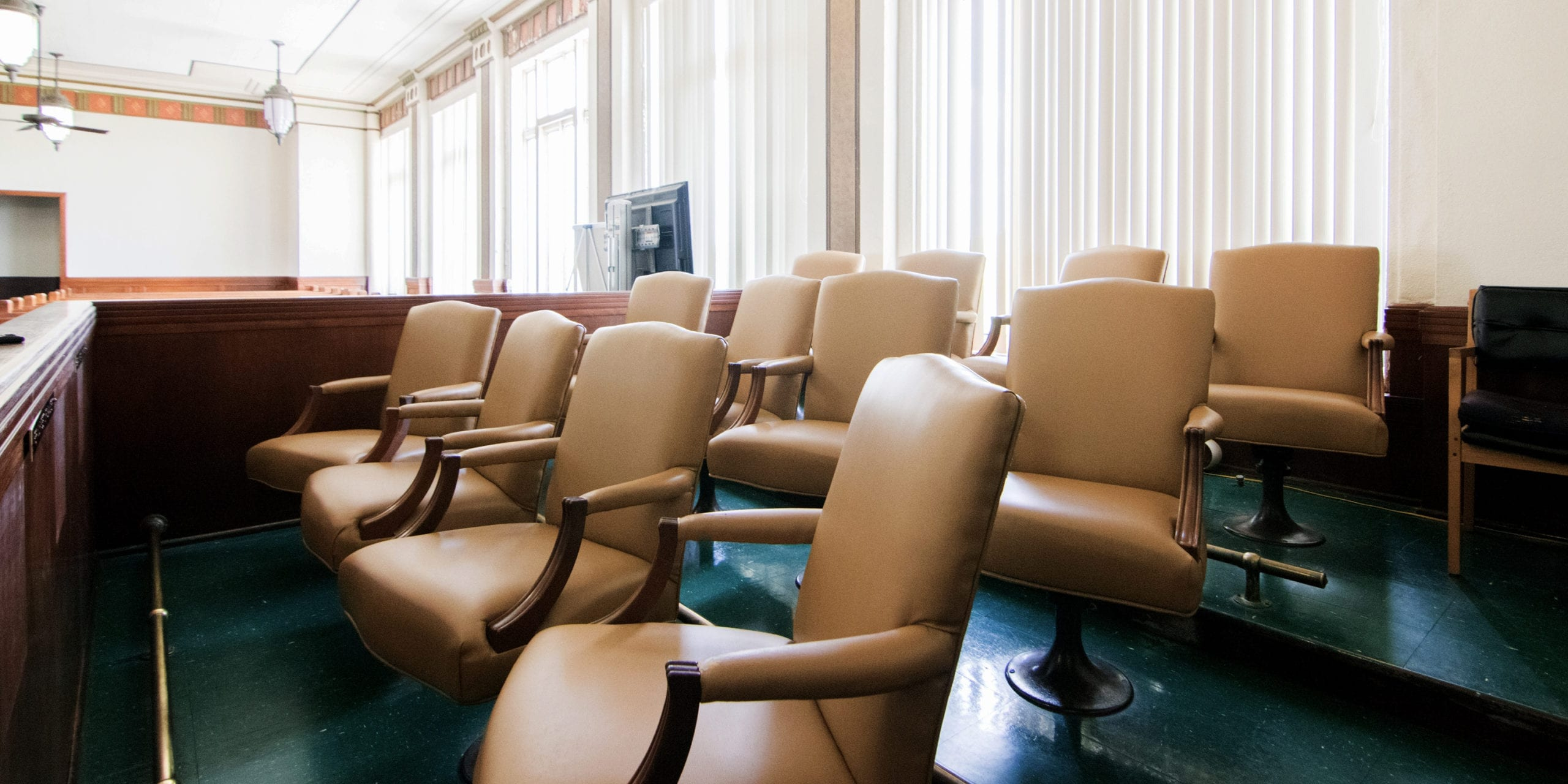 Chairs in a jury box. Photo by Flickr user Patrick Feller.