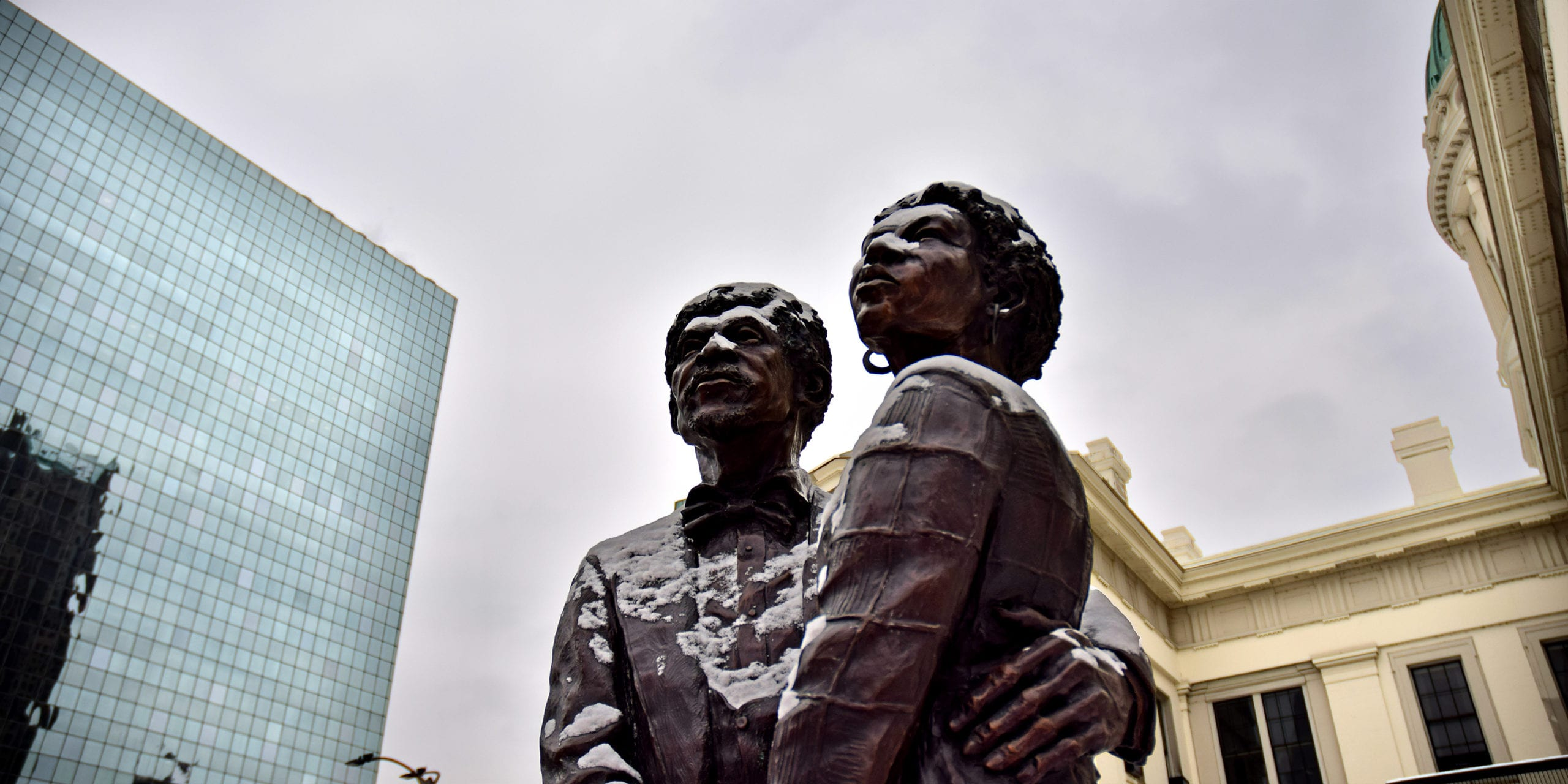 The Dred and Harriet Scott memorial statue, with Rasmussen Dickey Moore's St. Louis office in the background.