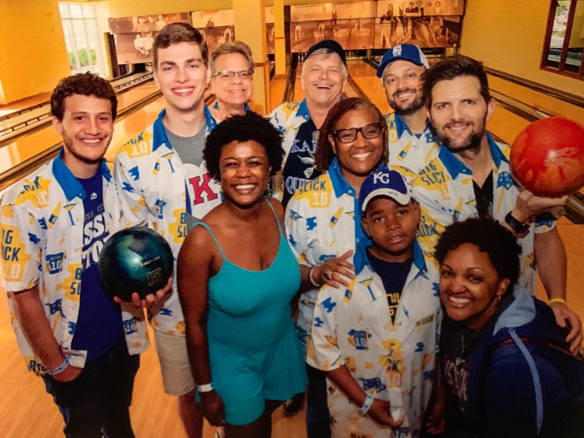RDM founding members Kurt Rasmussen, Clay Dickey, and their families bowling with actor Adam Scott during the Big Slick Celebrity Weekend.